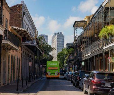 A Flix bus navigates a southern city.